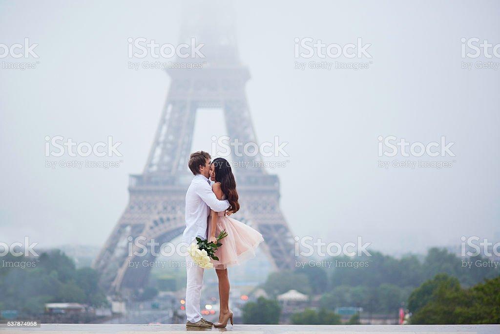 Beautiful romantic couple near the Eiffel tower in Paris stock photo