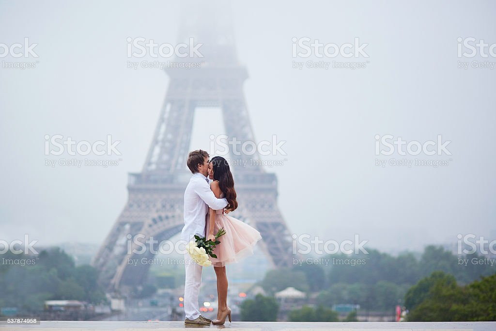 Beautiful romantic couple near the Eiffel tower in Paris stock photo