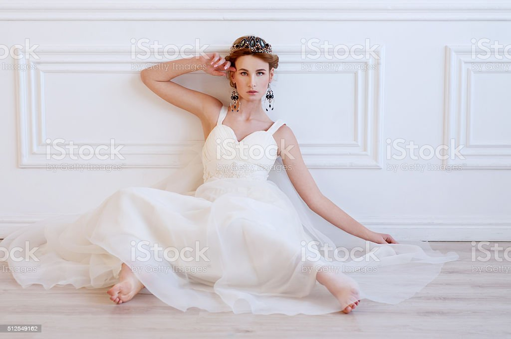 Beautiful royal bride wearing gorgeous beaded headpiece stock photo