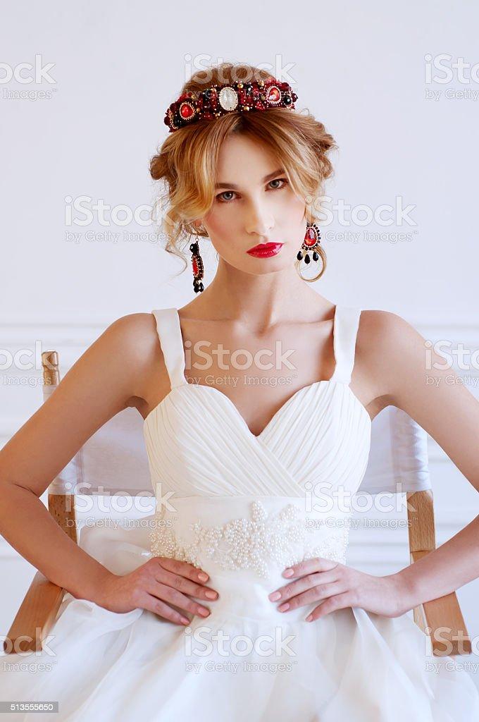 Beautiful royal bride wearing gorgeous beaded headpiece stock photo