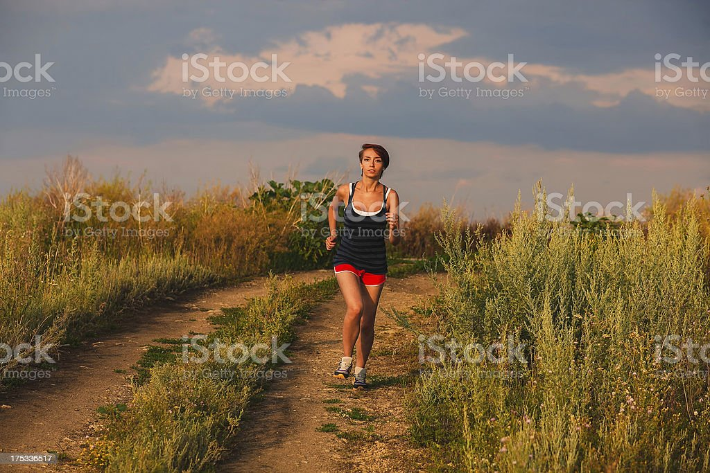 beautiful runs healthy young brunette woman athlete running outd royalty-free stock photo
