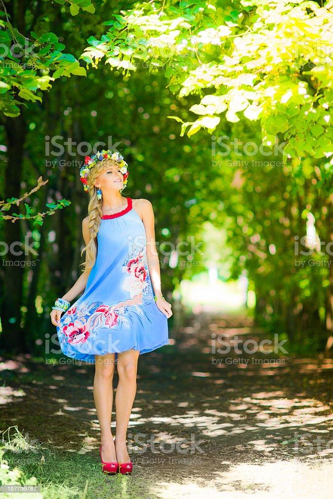 Beautiful russian woman wearing blue dress royalty-free stock photo