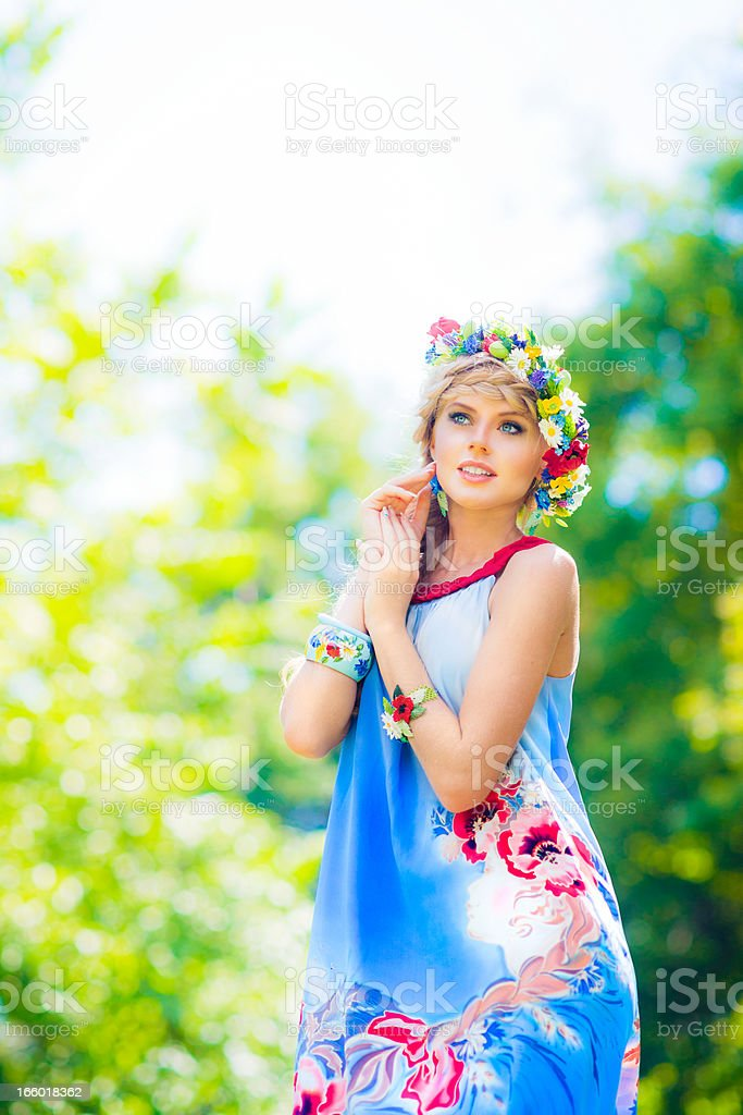 Beautiful russian woman wearing blue dress stock photo