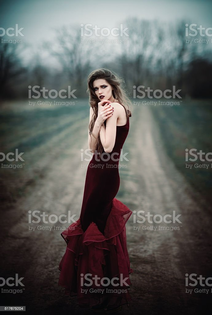 Beautiful sad girl in the autumnal field stock photo