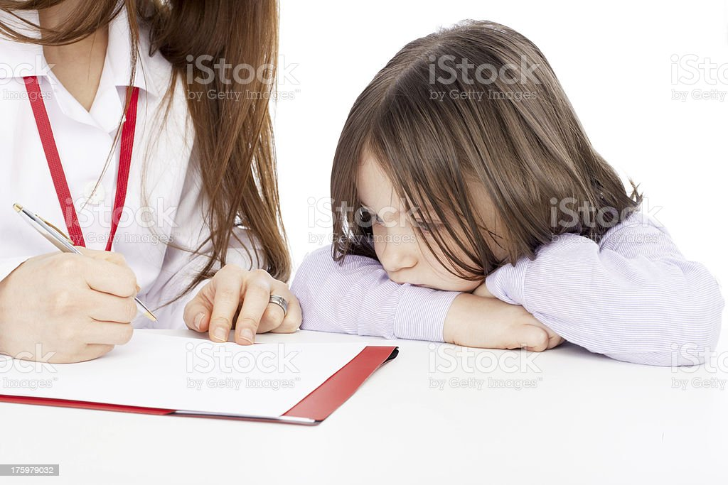 Beautiful Sad little girl with Doctor royalty-free stock photo