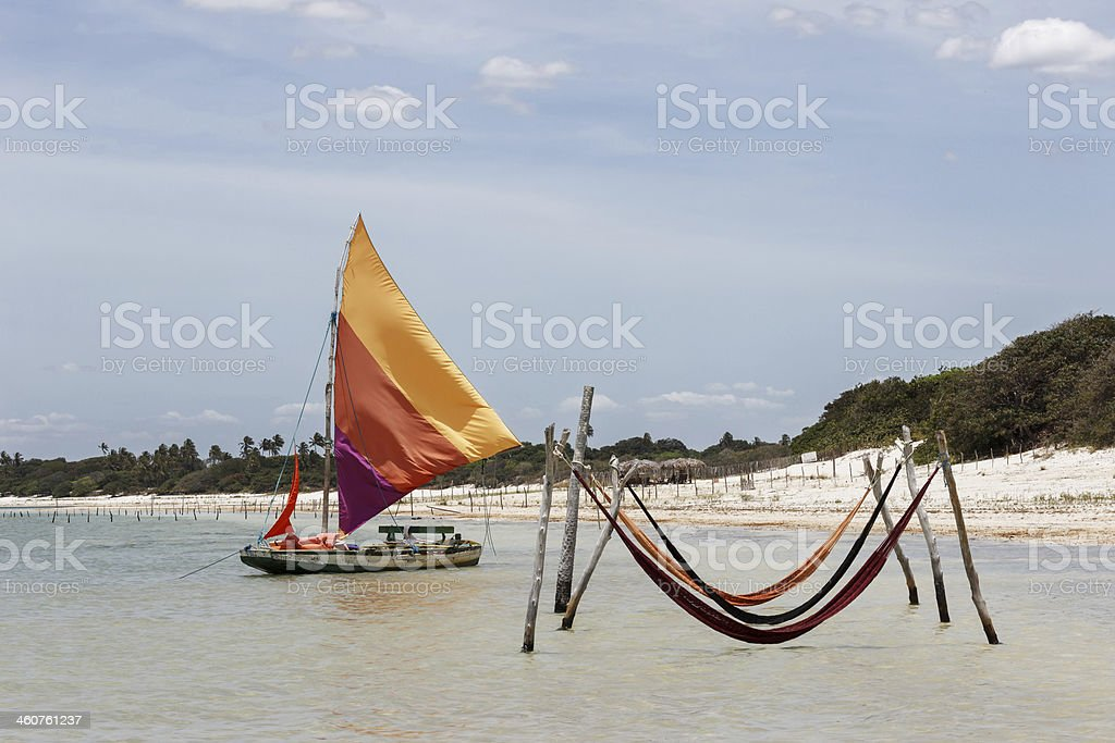 beautiful sail boat and hammocks (Jericoacoara, Brazil) stock photo
