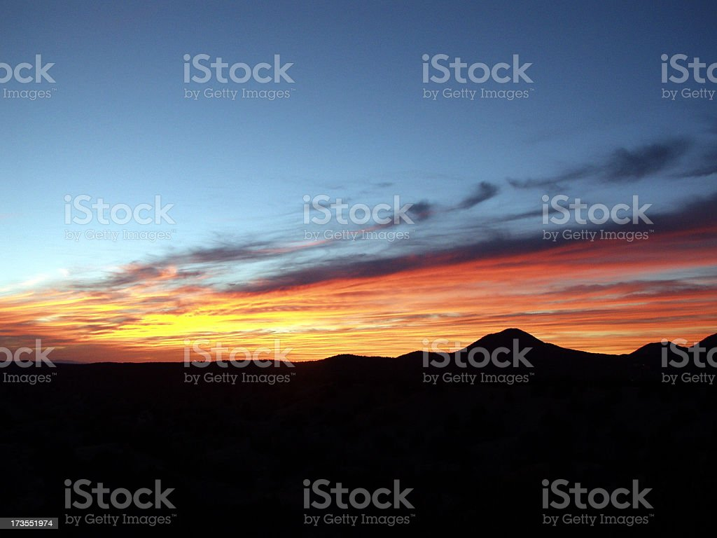 A beautiful Santa Fe sunset with silhouette of the mountains stock photo