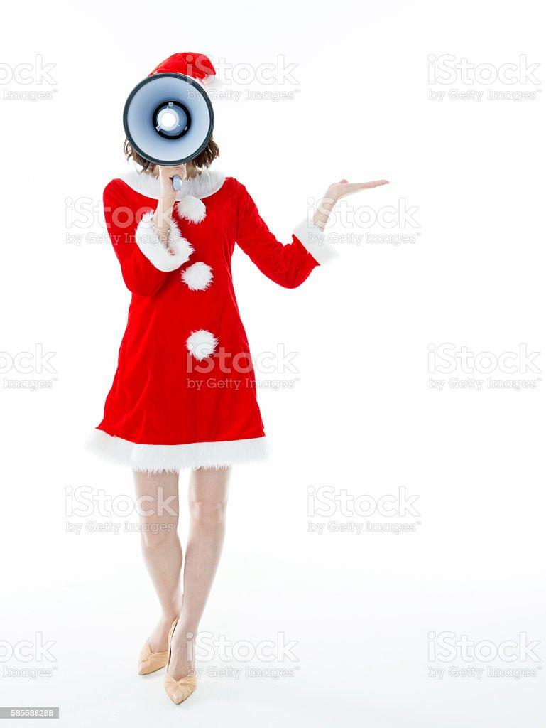 Beautiful santa girl holding a megaphone stock photo