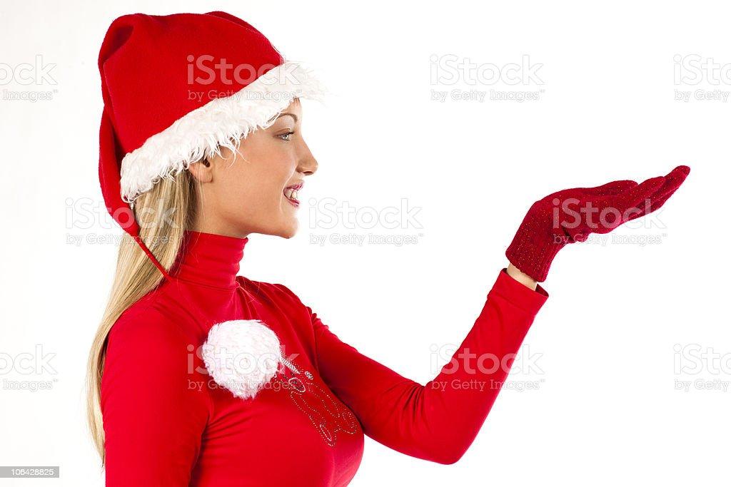 Beautiful Santa girl on white presenting/holding something royalty-free stock photo