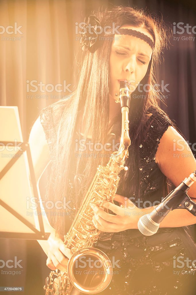 Beautiful saxophonist stock photo