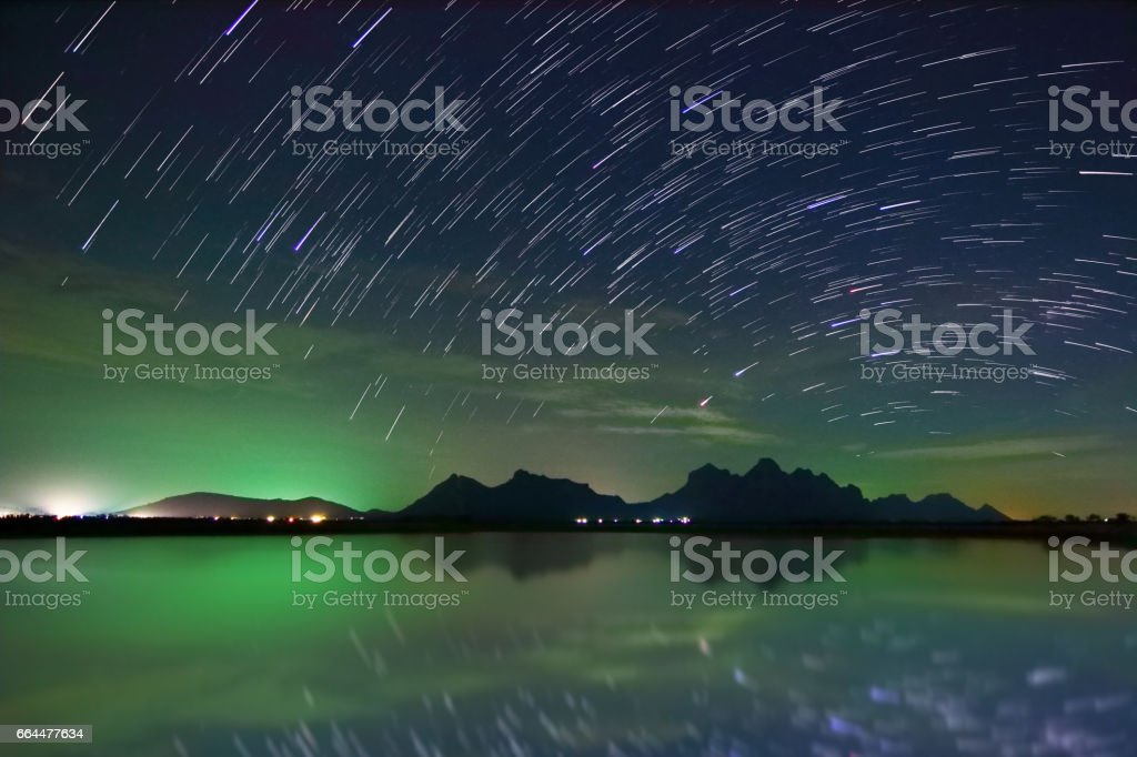 Beautiful scenery of the startrail on night sky at Khao Sam Roi Yot National Park,Prachuap Khiri Khan Province in Thailand. Long exposure shooting and high iso used make this photo have noise. stock photo