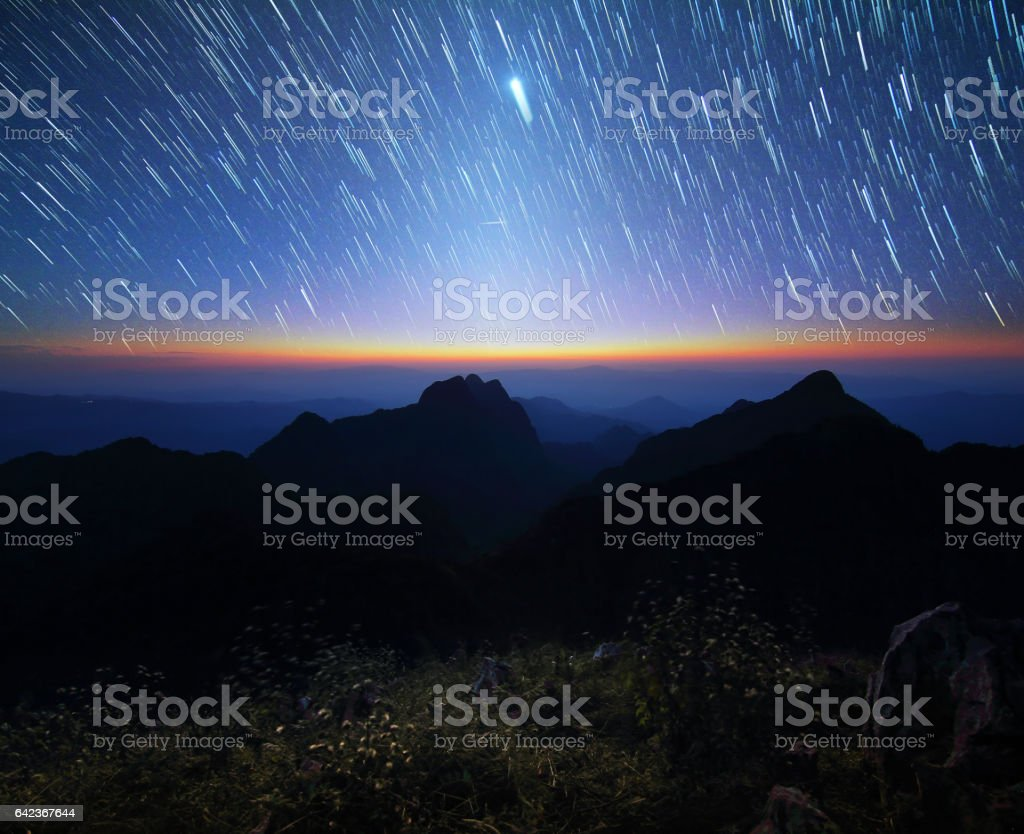Beautiful scenery of the startrail on sky at night at Doi Luang Chiang Dao at Chiang Mai in Thailand. Long exposure shooting and high iso used make this photo have noise stock photo