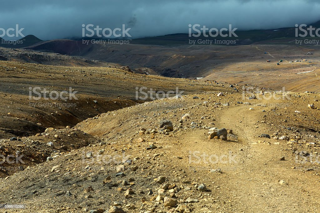 Beautiful scenery slopes of volcano Mutnovsky with clouds. stock photo