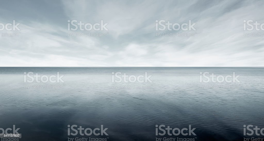 Beautiful sea level with fantasy dark sky stock photo