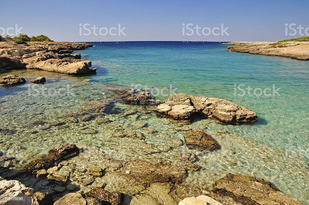 Beautiful sea of Porto Selvaggio's coast royalty-free stock photo