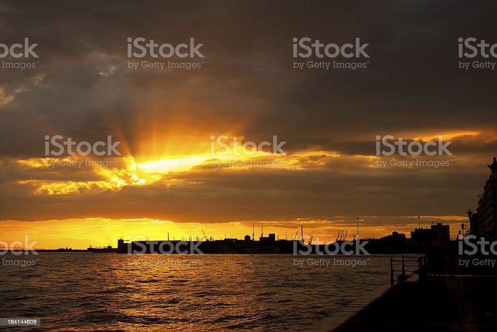 Beautiful sea sunset and industrial shipyard royalty-free stock photo