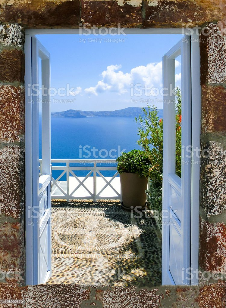 Beautiful sea view from the balcony. Santorini island, Greece. stock photo