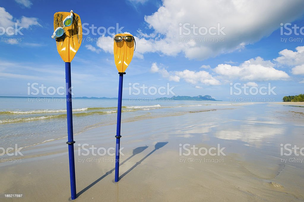 Beautiful sea with sunglass and kayak blade royalty-free stock photo