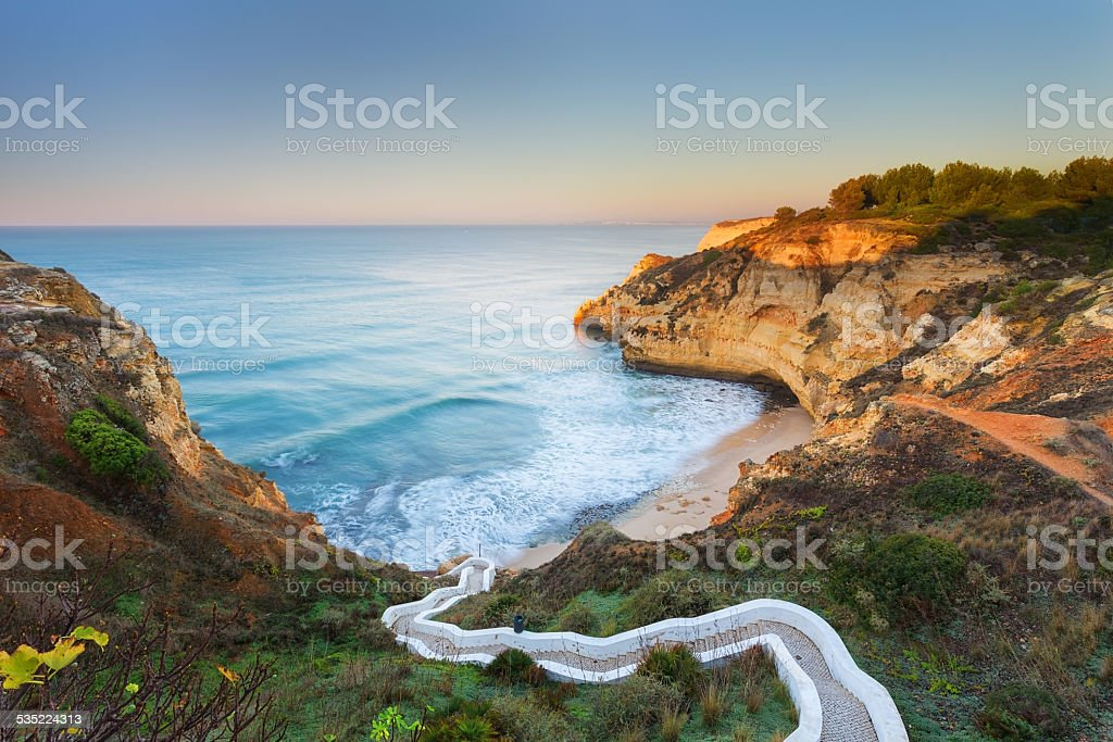 Beautiful seascape bay with serpentine steps. Portugal, Carvoeiro. stock photo