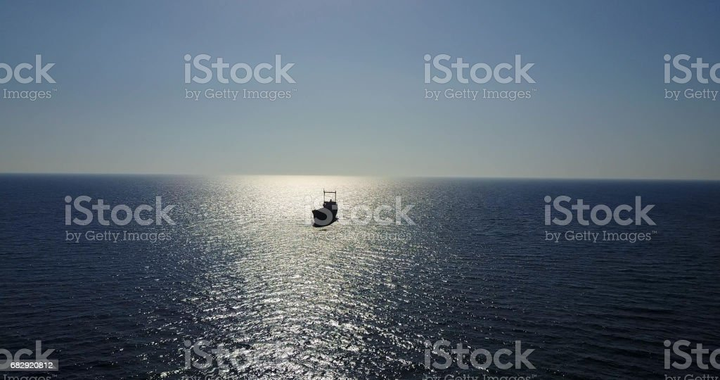 Beautiful seascape with old ship after the accident. stock photo