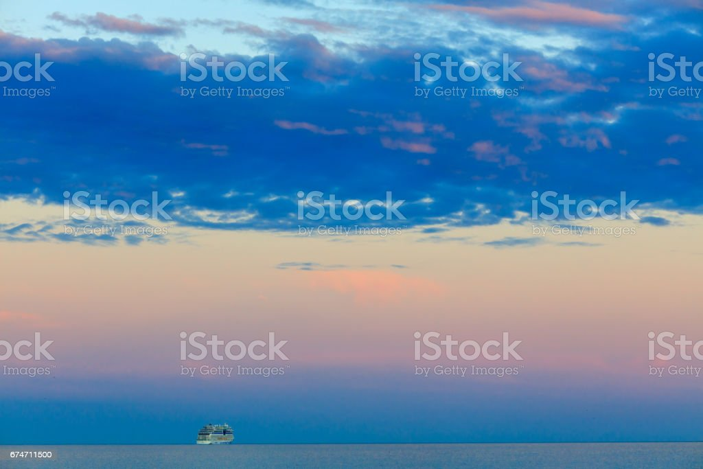 Beautiful seascape with vessel and sunset stock photo