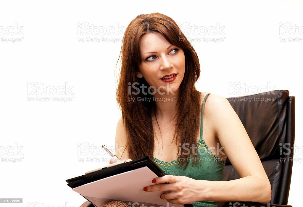 Beautiful secretary taking a note stock photo