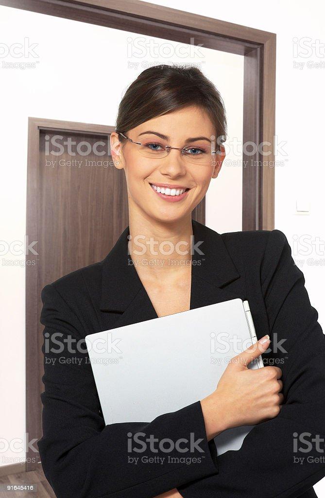 Beautiful secretary with laptop royalty-free stock photo