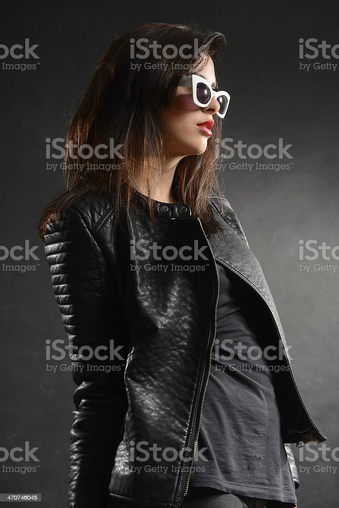 Beautiful seductive fashion model with dark hair posing in studio royalty-free stock photo