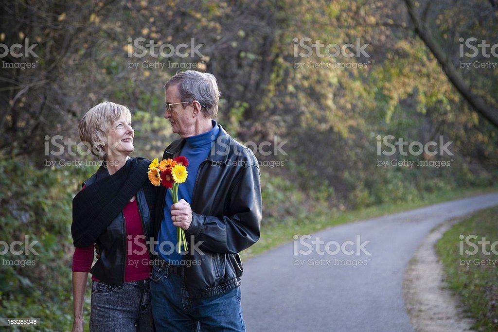 Beautiful Senior Couple Outside on a Walk royalty-free stock photo