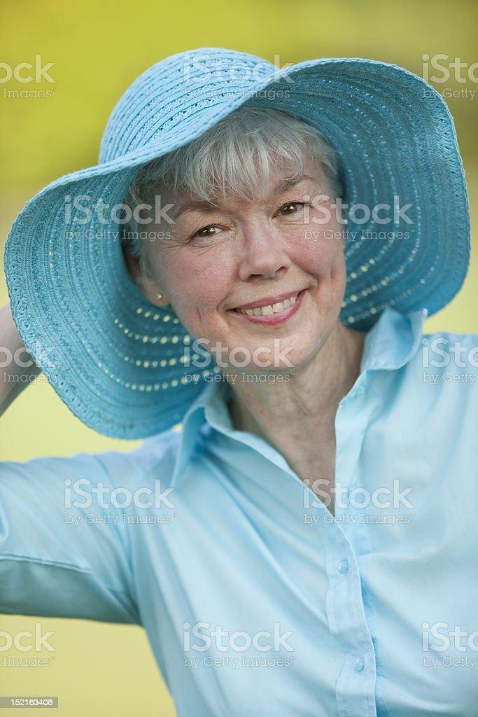 Beautiful Senior Lady Wearing Straw Hat royalty-free stock photo