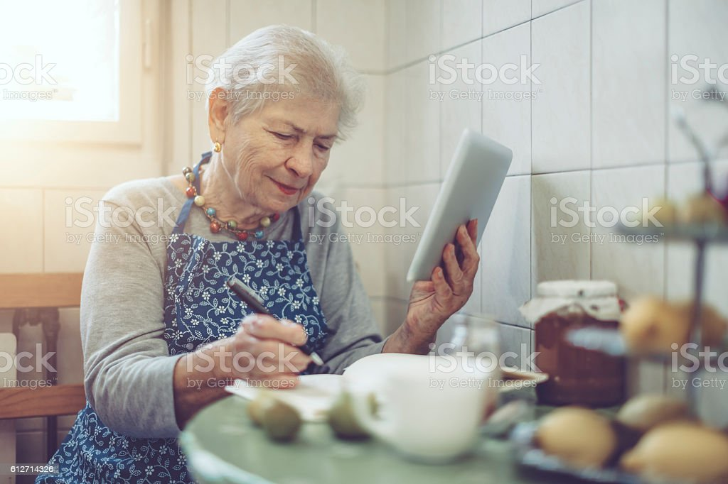 Beautiful senior woman at home stock photo