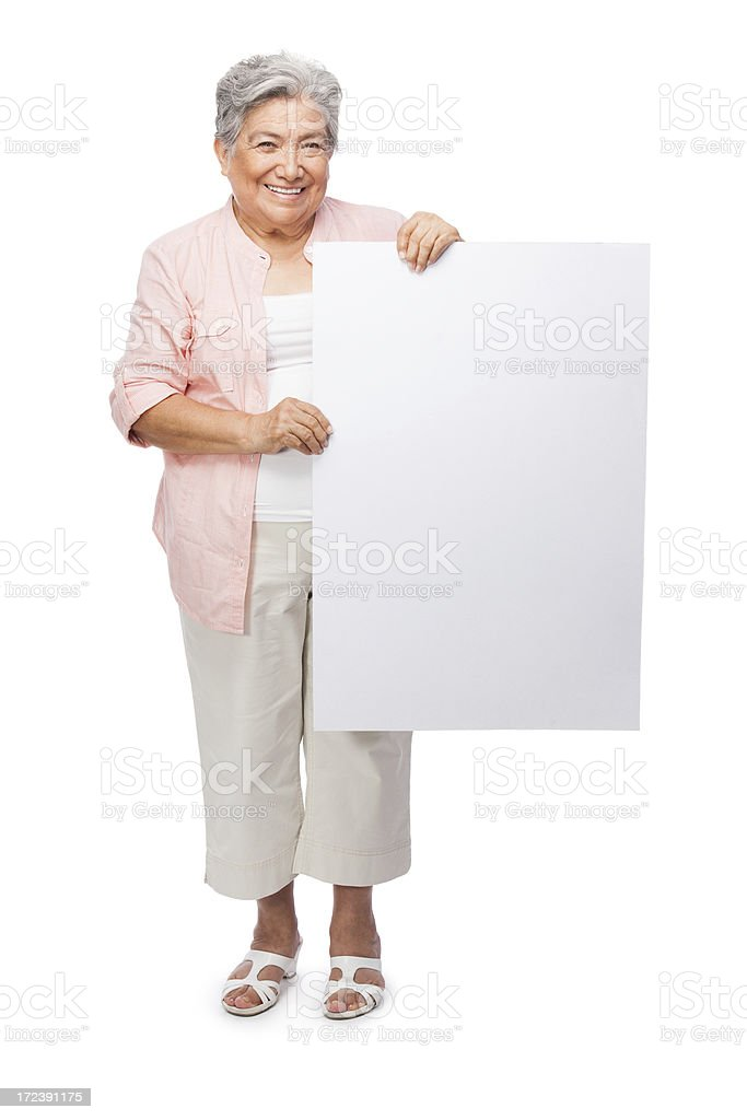 Beautiful senior woman holding a sign royalty-free stock photo