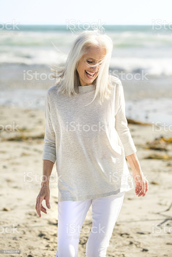 Beautiful senior woman on a beach. stock photo