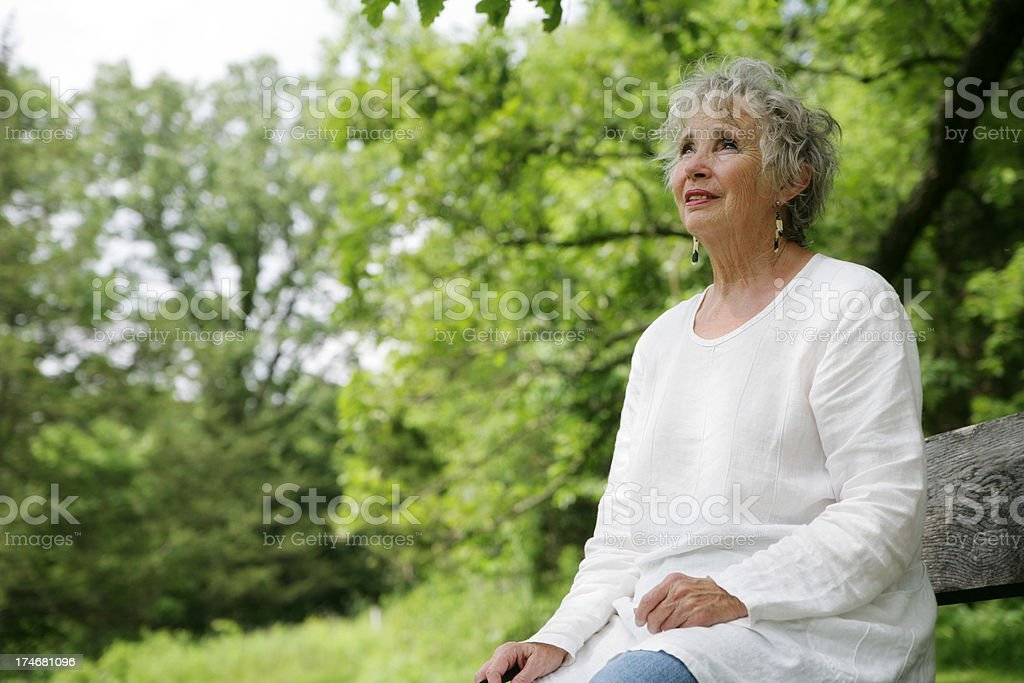 Beautiful Senior Woman Outside in Nature- Concerned Look stock photo