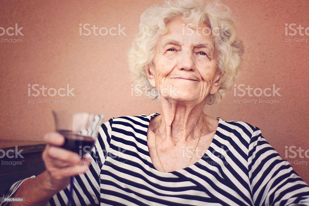 Beautiful Senior Woman Portrait Smug Expression Toned Image stock photo