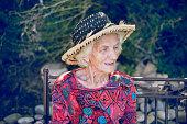 Beautiful Senior Woman Relaxing Outdoors in Back Yard