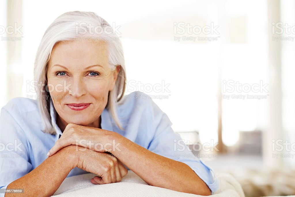 Beautiful senior woman smiling at home stock photo
