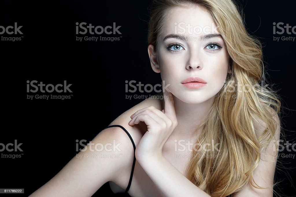Beautiful sensual blonde girl. Close-up of an attractive girl stock photo
