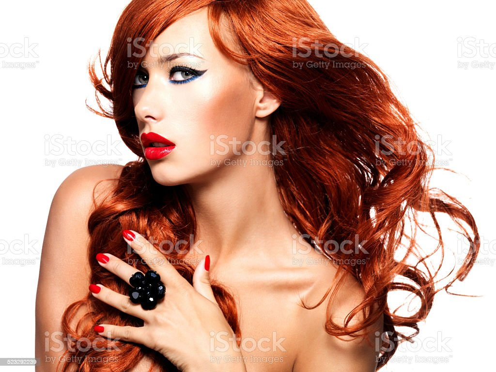 Beautiful sensual woman with long red hairs. stock photo