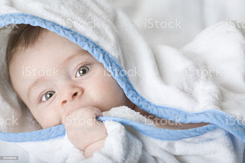 beautiful serene little baby in white towel royalty-free stock photo