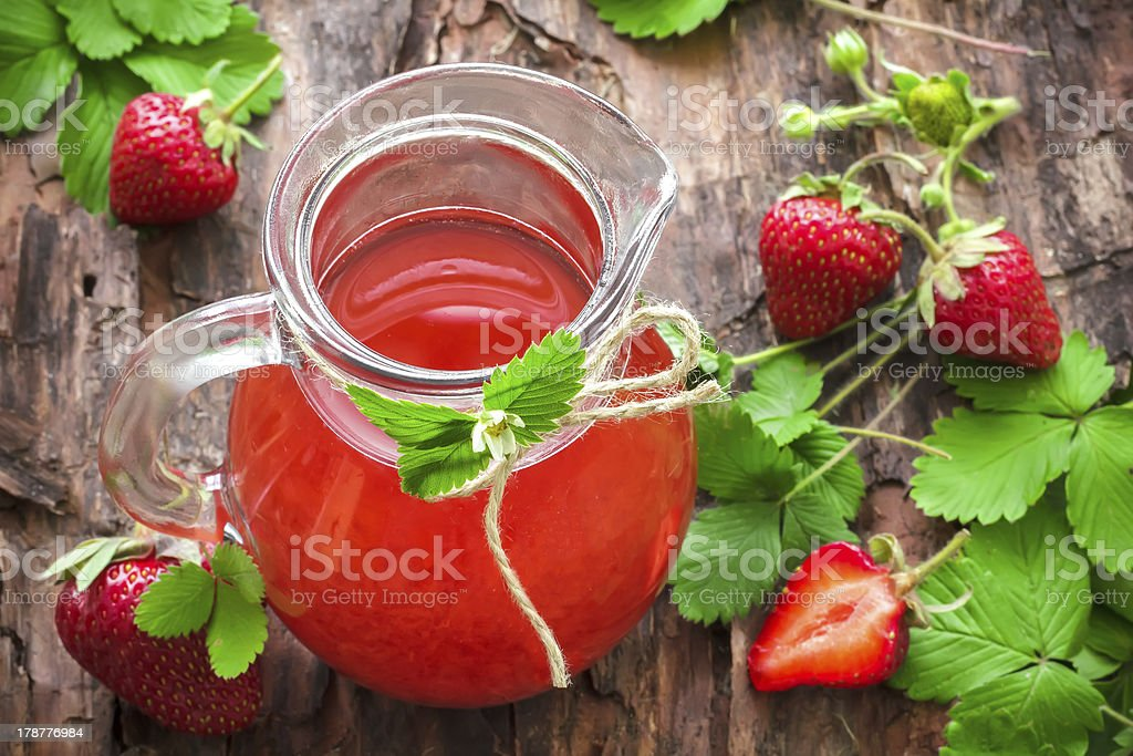 Beautiful setting of a strawberry and mint juice pitcher stock photo