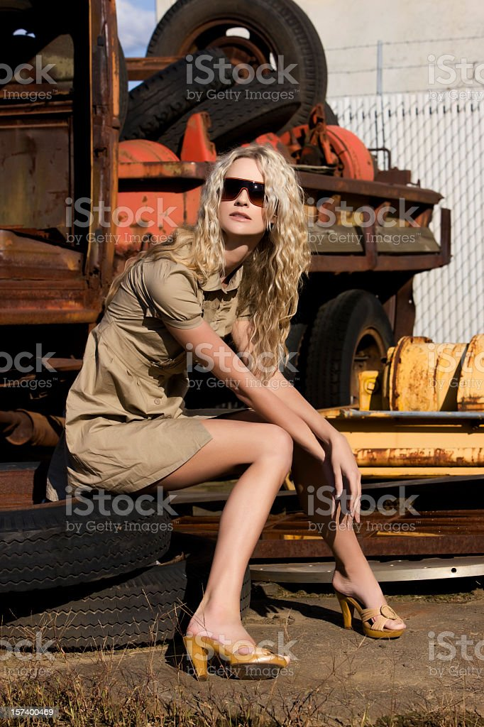 Beautiful, Sexy Blond Young Woman Fashion Model in Junk Yard royalty-free stock photo
