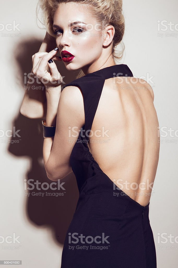 Beautiful sexy blonde girl with sensual lips, fashion hair, black stock photo