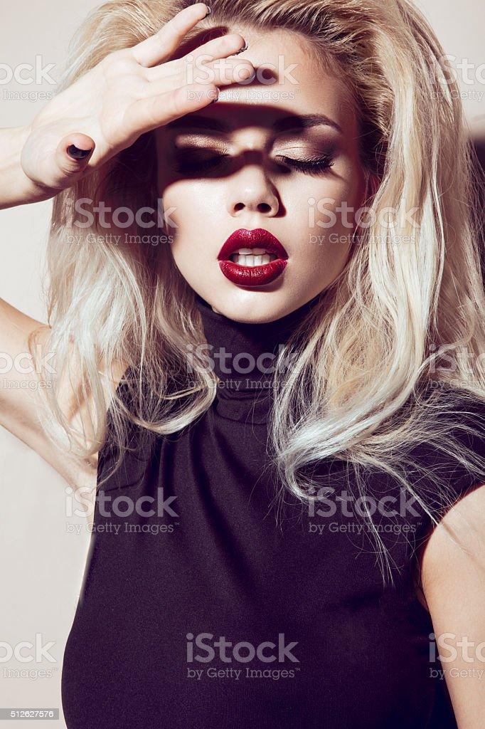Beautiful sexy blonde girl with sensual lips, fashion hair, stock photo