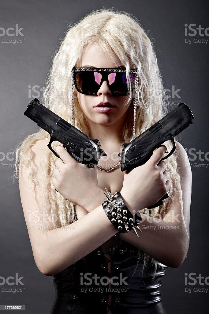 Beautiful sexy girl with guns stock photo
