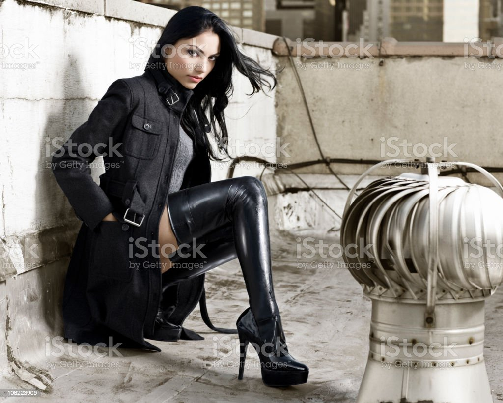 Beautiful, Sexy Hispanic Fashion Model in Boots on Rooftop stock photo