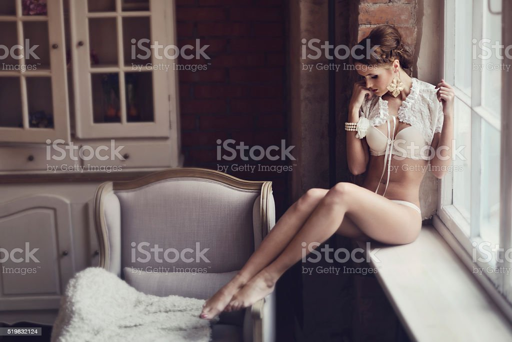 Beautiful sexy lady in elegant white panties and bra stock photo