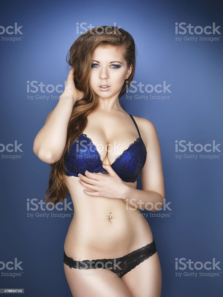 Beautiful sexy model with large breasts and blue eyes stock photo