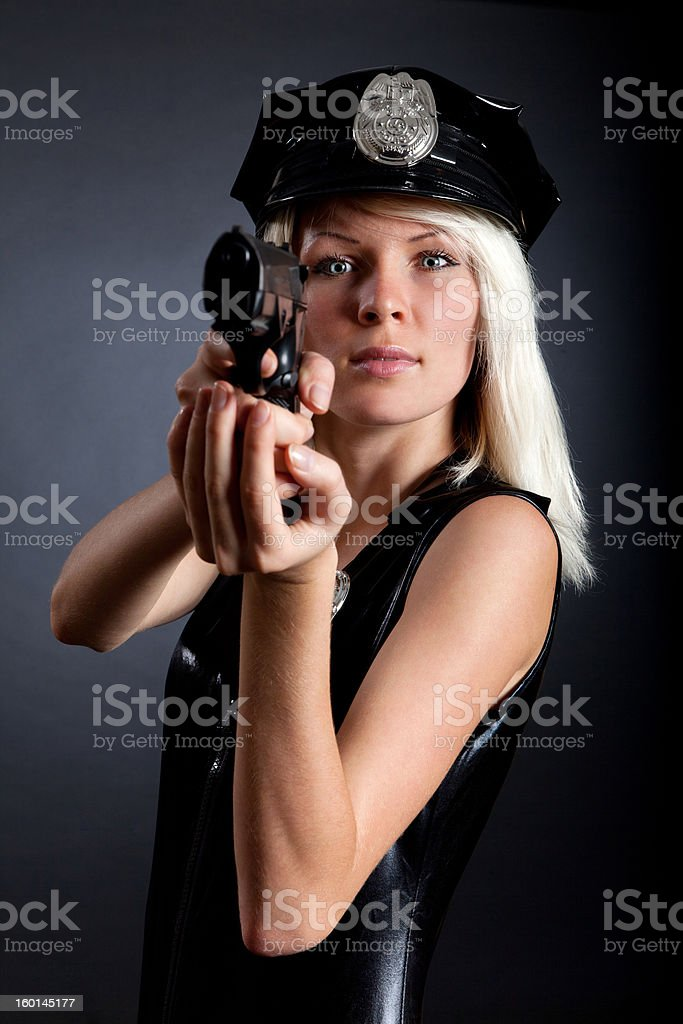 Beautiful sexy police girl with handgun and handcuffs royalty-free stock photo
