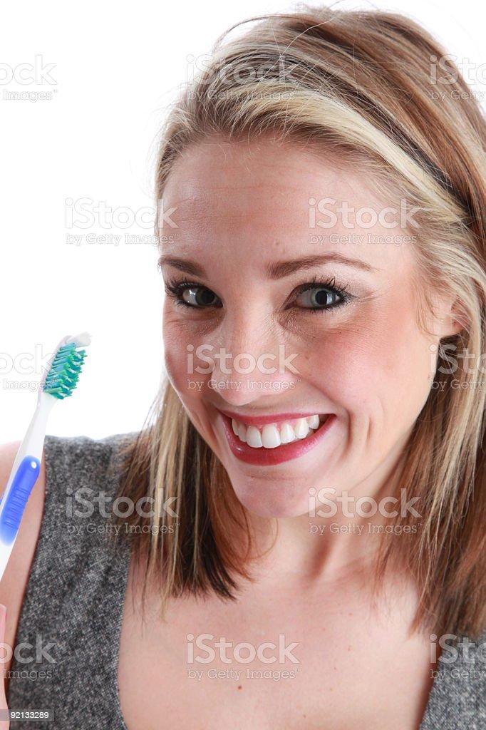 beautiful sexy  woman brushing her teeth royalty-free stock photo